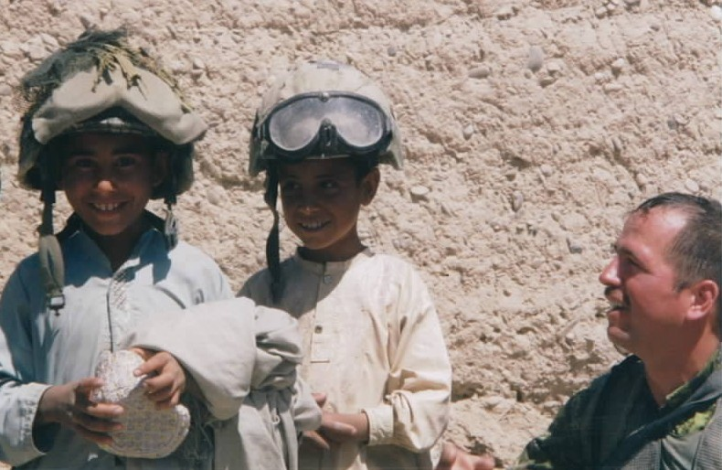 Canadian soldier with Afghan children