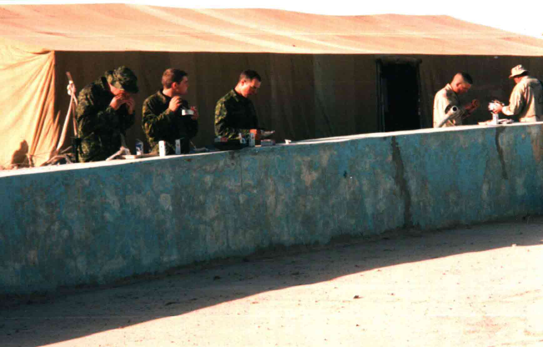 This is one for anyone out there who is familiar with the Boardwalk at Kandahar Air Field. It shows the dining facilities at the base in early 2002. The tent covers a bare concrete pad. No tables and chairs for the fine diners of Task Force Rakkasan.