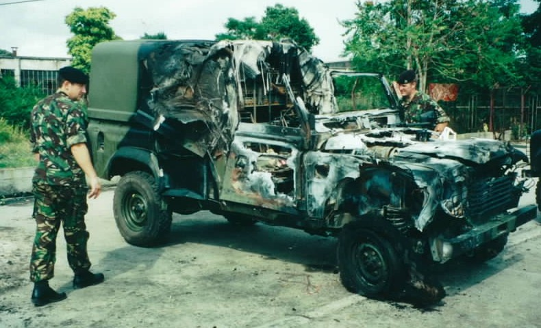 British troops examine a Landrover blown up by a bomb in Skopje before NATO entered Kosovo
