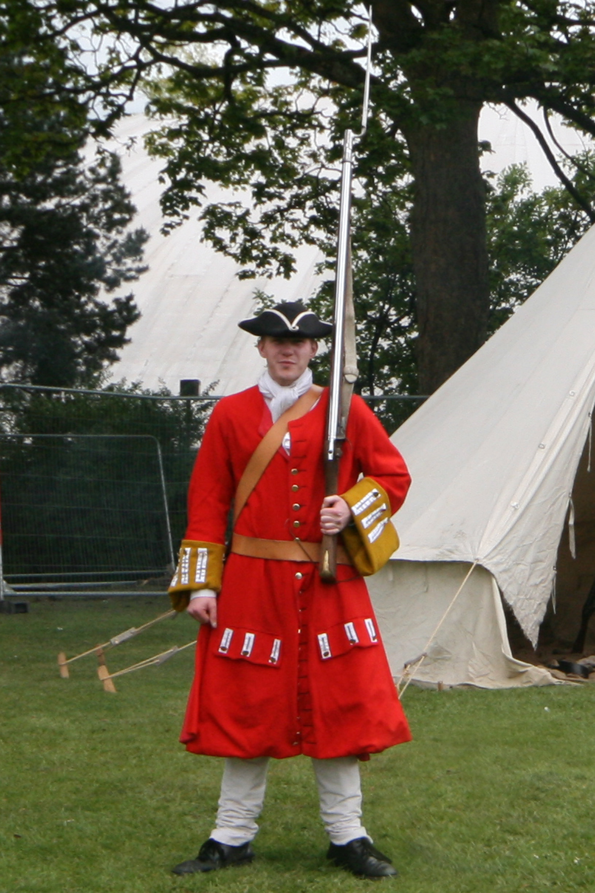 A member of Veritas Vincit military re-enactment group in typical 1715 infantry uniform