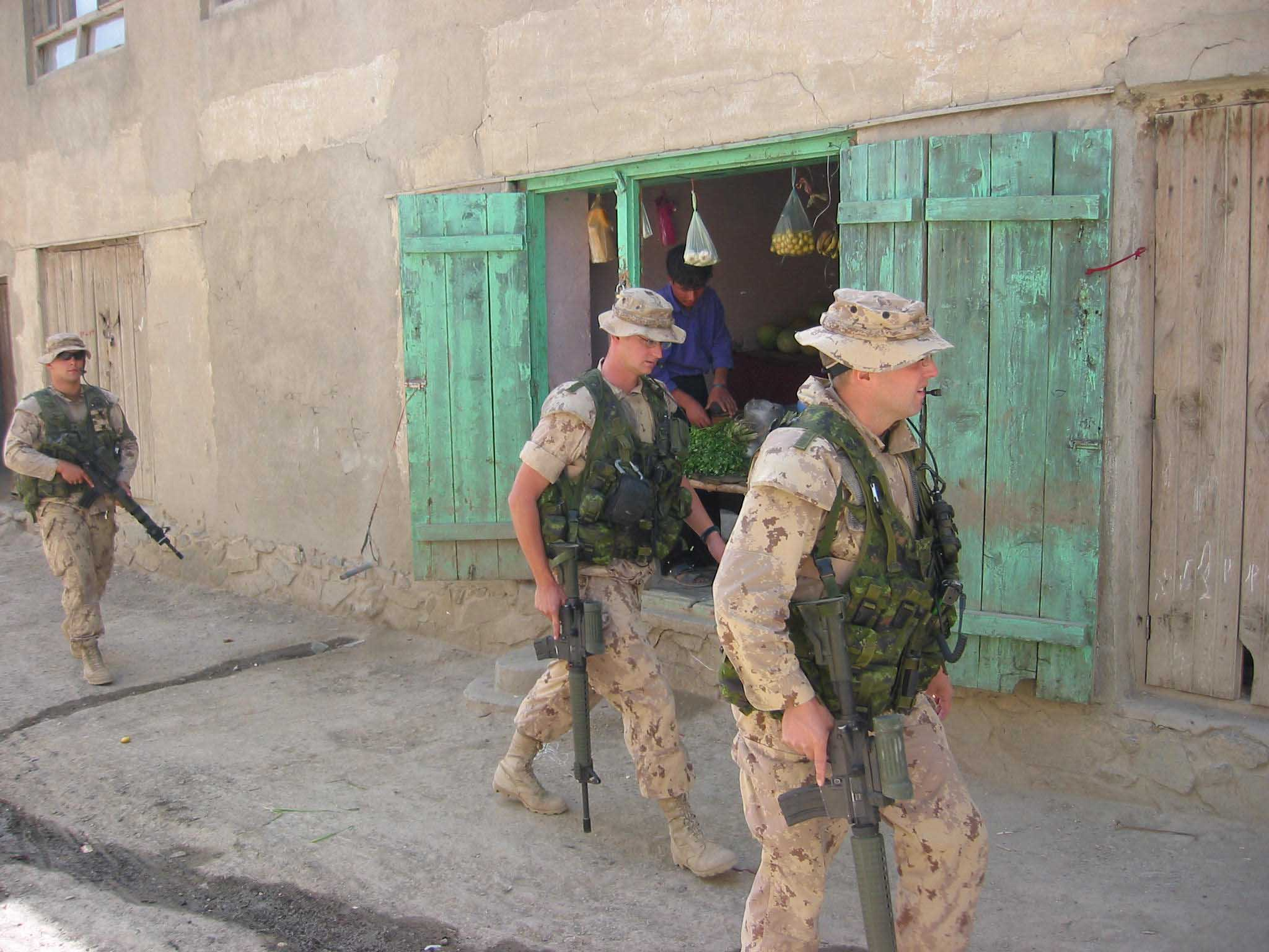 Canadian troops set off down an alleyway in Kabul to look at a possible site for a  small scale aid project to benefit city inhabitants.